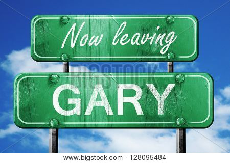 Leaving gary, green vintage road sign with rough lettering