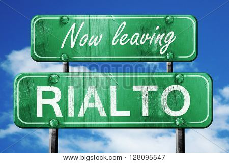 Leaving rialto, green vintage road sign with rough lettering