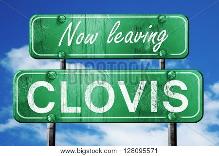 Leaving clovis, green vintage road sign with rough lettering