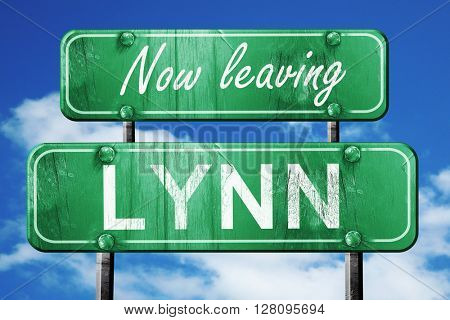 Leaving lynn, green vintage road sign with rough lettering