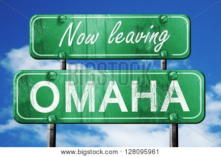 Leaving omaha, green vintage road sign with rough lettering