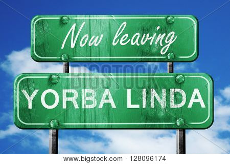 Leaving yorba linda, green vintage road sign with rough letterin