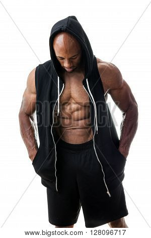 Toned and ripped lean muscle fitness man wearing a hooded sweatshirt isolated over a white background.