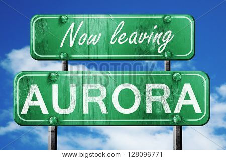 Leaving aurora, green vintage road sign with rough lettering