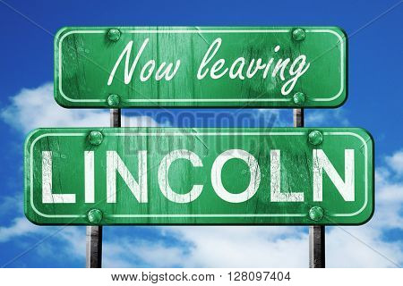 Leaving lincoln, green vintage road sign with rough lettering