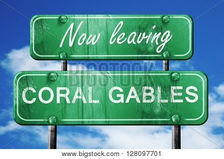 Leaving coral gables, green vintage road sign with rough letteri