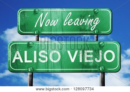 Leaving aliso viejo, green vintage road sign with rough letterin