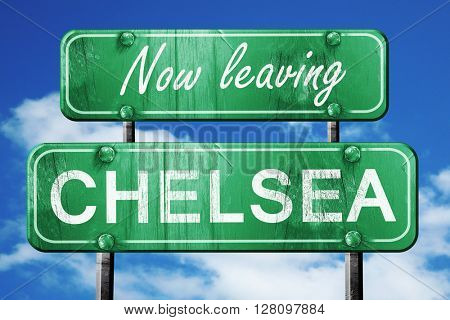 Leaving chelsea, green vintage road sign with rough lettering