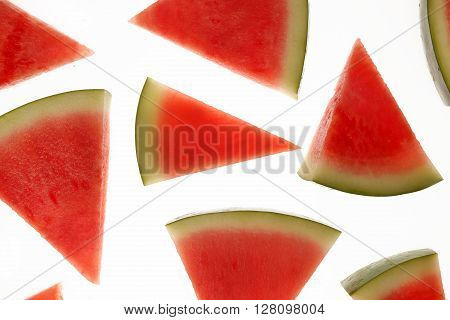 Slices of ripe watermelon on white background