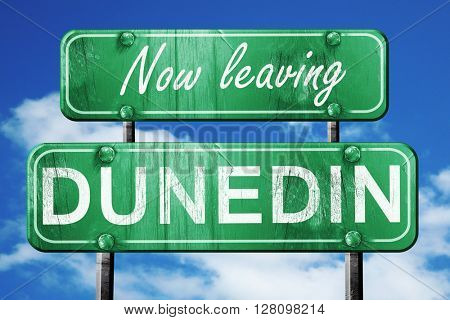 Leaving dunedin, green vintage road sign with rough lettering