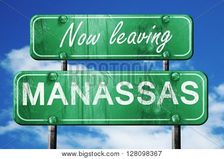 Leaving manassas, green vintage road sign with rough lettering