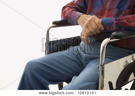 Torso shot of Caucasion elderly man sitting in wheelchair.