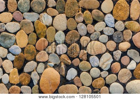 Wall round stone rock texture and background