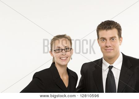Portrait of Caucasian mid-adult businessman and woman smiling and looking at viewer.