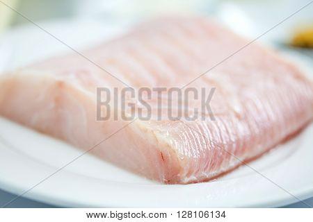 Fish fillet preparation : Raw sea bass fillet