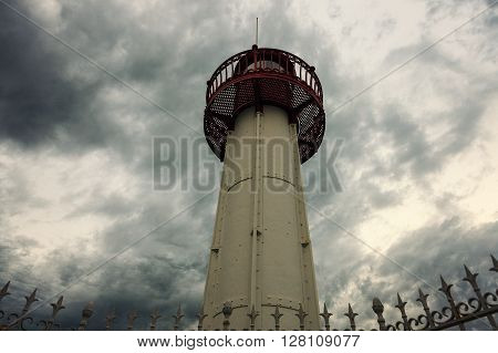Menton lighthouse under dramatic sky. Menton Provence-Alpes-Cote d'Azur France
