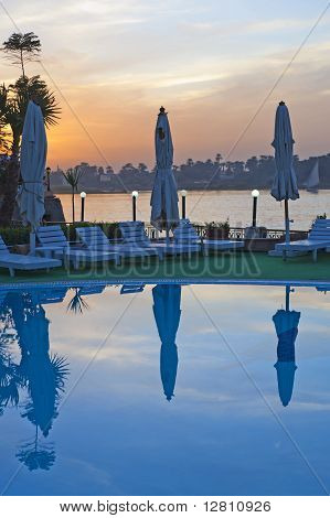 View From A Hotel Pool With Sunset