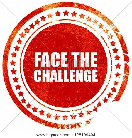 face the challenge, red grunge stamp on solid background
