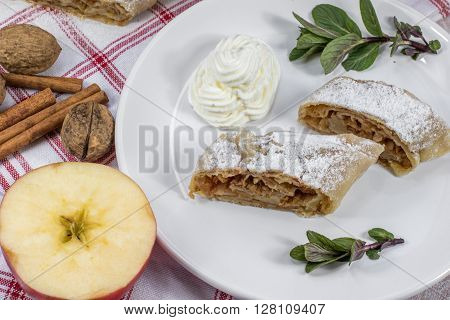 Two Slices Homemade Apple Strudel on Plate with Whipped Cream Mint and Apple