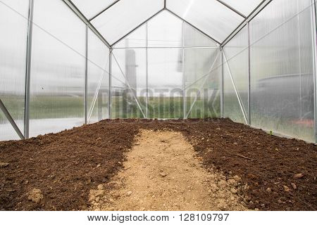 View into an Empty Small Greenhouse Ready for Spring Planting Vegetable