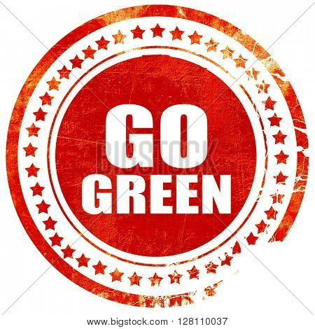 go green, red grunge stamp on solid background