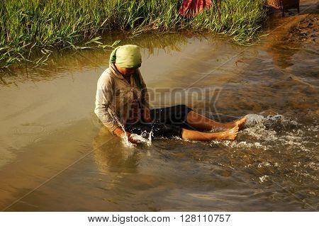 Vietnamese Woman Bath In Stream