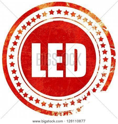 led, red grunge stamp on solid background
