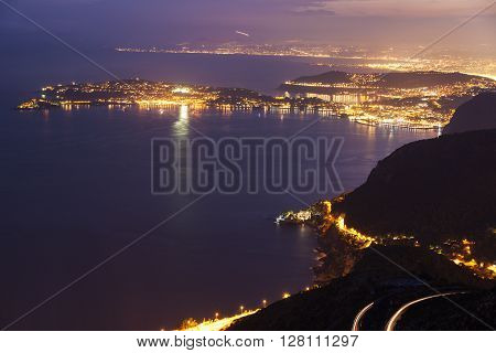 Distant view of Saint Jean Cap Ferrat and Nice at sunset seen from Monaco. Saint Jean Cap Ferrat French Riviera France.