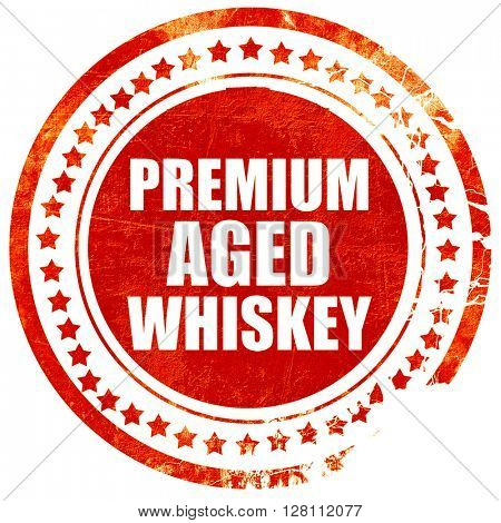premium aged whiskey, red grunge stamp on solid background
