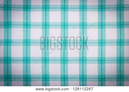 Colorful fabric as background checkered tablecloth texture as backdrop