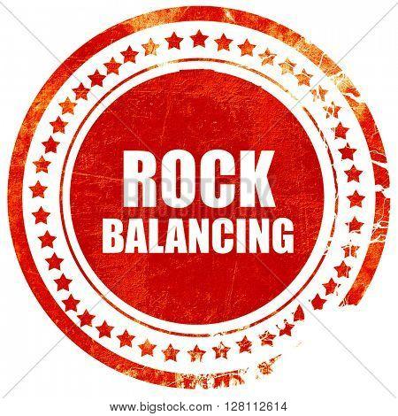 rock balancing, red grunge stamp on solid background