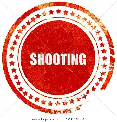 shooting, red grunge stamp on solid background