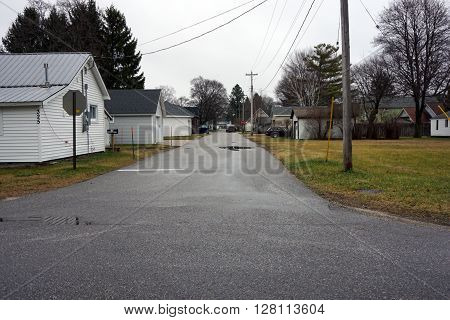 HARBOR SPRINGS, MICHIGAN / UNITED STATES - DECEMBER 23, 2015: A paved alley in a residential area of Harbor Springs.