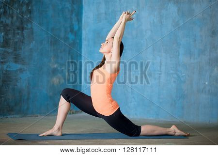 Beautiful Woman Practicing Low Lunge Exercise