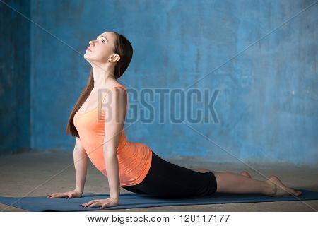 Young Woman Doing Upward-facing Dog Pose