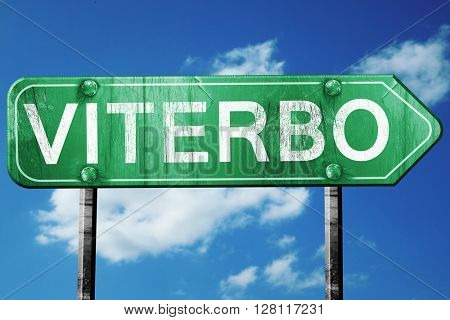 Viterbo road sign, 3D rendering, vintage green with clouds backg