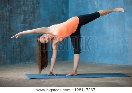 Sporty Beautiful Young Woman Doing Half Moon Pose