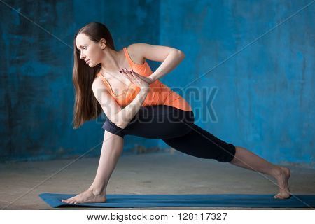 Sporty Beautiful Young Woman Doing Parivritta Parsvakonasana Pose