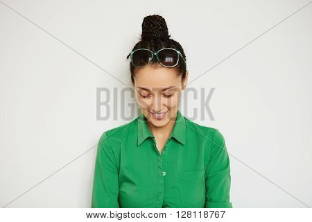 Cropped Shot Of Brunette Female Model Wearing Green Shirt Looking And Smiling Down While Posing Agai