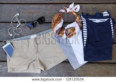 Woman's basic summer fashion - chino shorts with three cotton t shirts