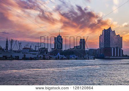 Sunrise in Hamburg - seen accros Elbe River. Hamburg Germany