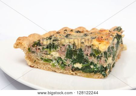 Quiche lorraine preparation : Slice of spinach and tuna quiche lorraine baked