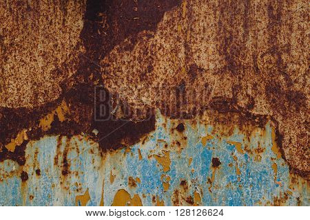 Detail of corroded metal plate with blue paint peeled of oxidized metal plate texture
