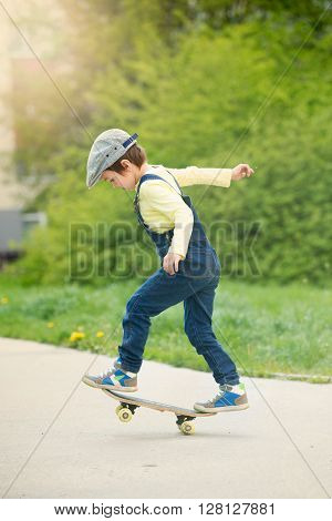 Adorable Preschool Child Skateboarding On The Street