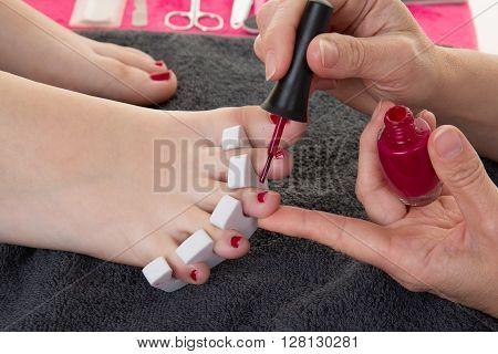Closeup Photo Of A Female Feet At Spa Salon On Pedicure Procedure.