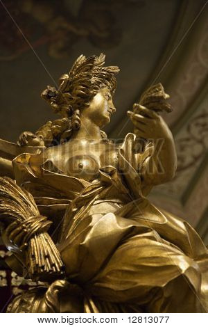Sculpture of woman on coach made for Marques de Abrantes in Lisbon Coach Museum, Lisbon, Portugal.