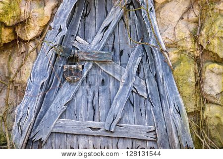 old wooden door for a stone hut or hovel with a padlock and a blank space for the text ** Note: Visible grain at 100%, best at smaller sizes