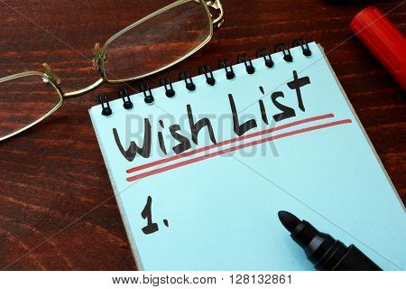Wish list written on a notepad with marker.
