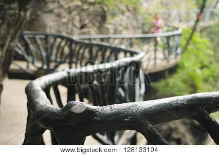 The curved and winding railing on the cliff walk on Tianmenshan (mount tianmen) located in the city of Zhangjiajie Hunan province China.
