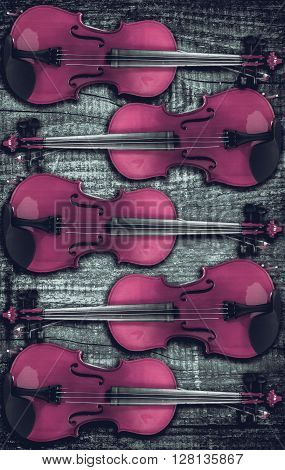 Violin on grey wooden background. With space for text writing.